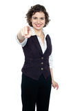 Woman in formals pointing forward Royalty Free Stock Image