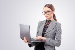 Woman in formalwear working on laptop Royalty Free Stock Image