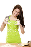 Woman forming claws with messy dough covered hands Royalty Free Stock Photo