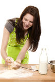 Woman forming dough with her hands Stock Photos
