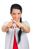 Woman  forming with fingers a cross sign Royalty Free Stock Photo