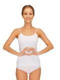Woman forming heart shape on belly Royalty Free Stock Photos