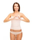 Woman forming heart shape Royalty Free Stock Images