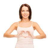 Woman forming heart shape Royalty Free Stock Photo