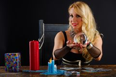 Woman fortune teller with crystal ball portrait. On black Royalty Free Stock Photos