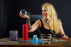 Woman fortune teller with crystal ball portrait Royalty Free Stock Image