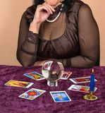 Woman fortune teller. Woman laid on the table the Tarot cards for fortune telling Stock Images