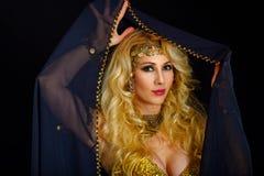 Woman fortune teller portrait at black Stock Image