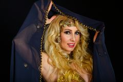 Woman fortune teller portrait at black Royalty Free Stock Images