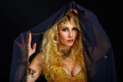 Woman fortune teller portrait at black Royalty Free Stock Image