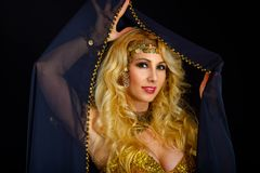 Woman fortune teller portrait at black Stock Images