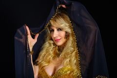 Woman fortune teller portrait at black Royalty Free Stock Photography