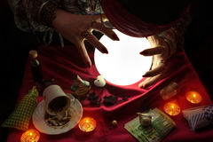 Woman fortune teller staring at crystal ball. Gypsy woman fortune teller staring at crystal ball Stock Image