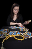 The woman fortuneteller. The woman the fortuneteller on a black background Royalty Free Stock Photos