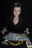 The woman fortuneteller. The woman the fortuneteller on a black background stock photos