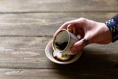 Woman fortuneteller hand with cup of coffee. Grounds Royalty Free Stock Images