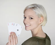 Woman with four aces Stock Photo