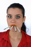 Woman with four cigarettes Royalty Free Stock Photography