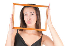 Woman with frame royalty free stock photography