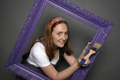 Woman and frame Royalty Free Stock Photography