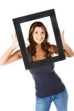 Woman with a frame Royalty Free Stock Photos