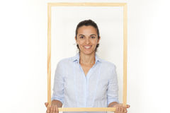 Woman with a frame Stock Image