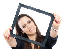 Woman with a frame Royalty Free Stock Photography