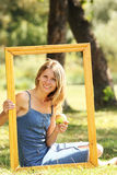 Woman in a frame Royalty Free Stock Photo