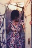 Woman through frame