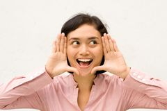 Woman framing face with hands Royalty Free Stock Photo