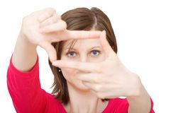 Woman with framing hands. Young brunette woman with framing hands royalty free stock photography