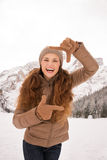Woman framing with hands outdoors among snow-capped mountains Royalty Free Stock Photography