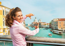 Woman framing with hands in venice, italy Royalty Free Stock Photography
