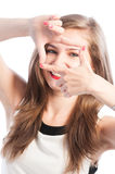 Woman framing her eyes with fingers Stock Photography