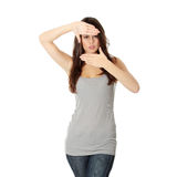 Woman framing her face with hands Royalty Free Stock Image