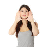 Woman framing her face with hands Stock Photo