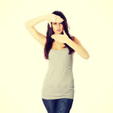 Woman framing her face with hands Royalty Free Stock Photography
