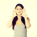 Woman framing her face with hands Royalty Free Stock Images