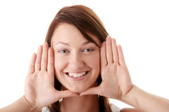 Woman framing her face with her hands Royalty Free Stock Photos