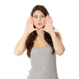 Woman Framing Her Face With Hands Stock Image