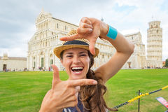 Woman framing on piazza dei miracoli, pisa Royalty Free Stock Photo