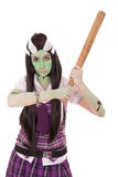 Woman in Frankenstein costume with bat Stock Photo
