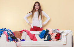 Woman freaking out in messy room home. Royalty Free Stock Photography