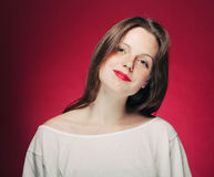Woman freckle portrait on color background red and pink Stock Image