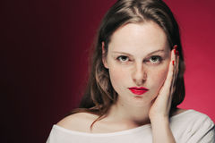 Woman freckle portrait on color background red and pink Royalty Free Stock Image