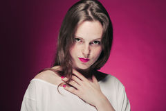 Woman freckle portrait on color background red and pink Stock Photos