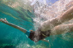 Woman free diving Royalty Free Stock Image