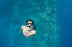 Woman free diving on a coral reef Royalty Free Stock Photos