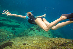 Woman free diving Stock Photos
