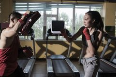 The Woman free sparring At The Gym and coaches. Women free sparring At The Gym royalty free stock image